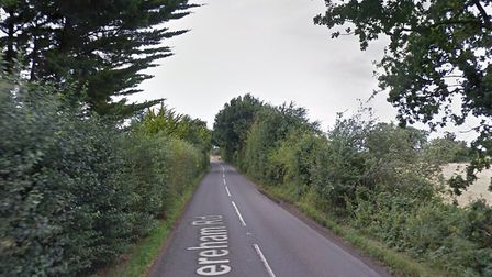 A stretch of the B1135 between Garvestone and Kimberley. A lorry has jackknifed on the road, causing