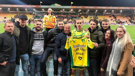 Todd Cantwell with a shirt in memory of Bradley Raper following Norwich City's victory over Aston Vi