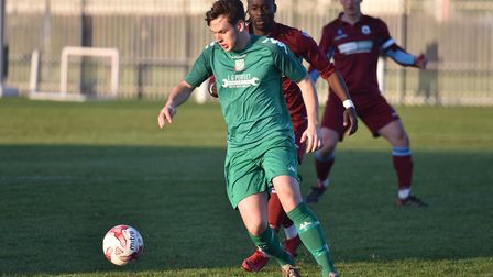 Action from the game between Thetford and Gorleston (green). Picture: Sonya Duncan