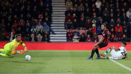 Onel Hernandez slides the ball past Artur Boruc to get the Canaries back on level terms on the south
