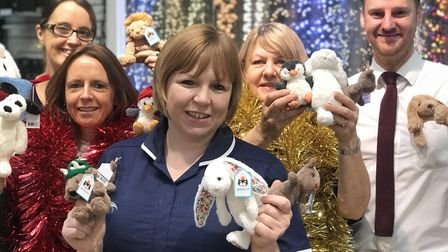 L-R: John Lewis staff Jacey Hymas, Alison Rowland, Ann Walker and Ashley Edwards hand over some of t