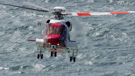 A file photo of a S92 Coastguard search and rescue helicopter, similar to the one which went to the