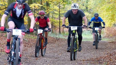 Paul Groombridge (left) and Will Dorsett overtake lapped riders at the Thetford Forest MTB racing Pi