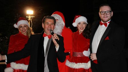 Olly Day and fellow Pier Show stars on stage for the Cromer Christmas lights countdown outside the p