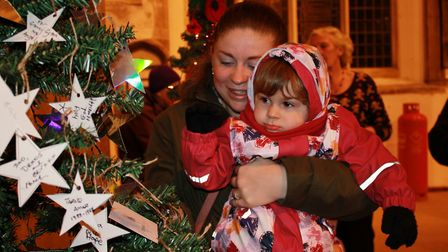 Lisa Nudchanad and two-year-old daughter Rosie admire one of the Christmas tree festival displays in