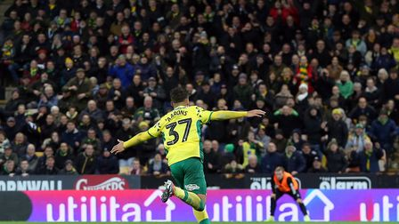 Max Aarons heads straight for the home supporters as he celebrates his first league goal for Norwich