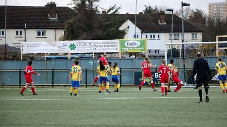 Grace Parker jumps above the Haringey defence to head home Acle's goal Picture: Natasha Thompson