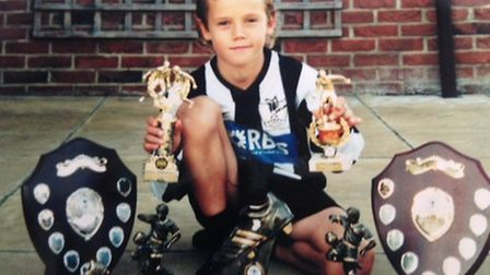 Todd Cantwell with his vast collection of trophies when playing for Dereham Town. Picture: Supplied