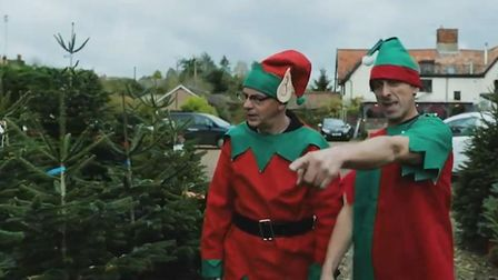 Employees Keith Bickers and Shaun Woodcock as two elves in the cheery festive film from Vincent's Ga