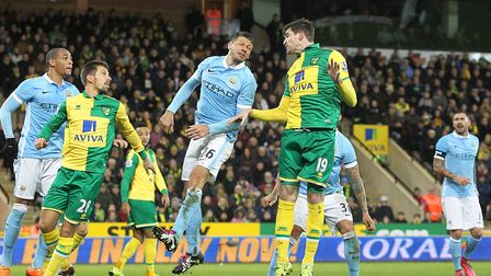 Kyle Lafferty made a rare start for Norwich as Manchester City won 3-0 at Carrow Road in the FA Cup
