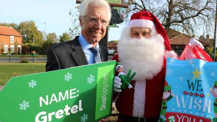 Councillor Paul claussen and Santa looking for cheeky elves in Attleborough. Picture: Breckland Coun