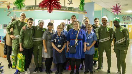 Norwich City players visited children at the Norfolk and Norwich Hospital and gave them Christmas gi