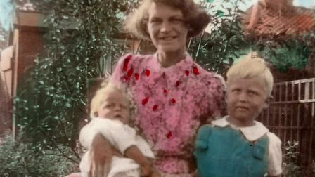 Iris Reeve with her two oldest sons, Robin and Terry, in the family garden in Bungay in 1943 Pictu