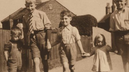 Chris, his brothers and sister set off for an afternoon stroll in about 1952. 'I'm the one in the mi
