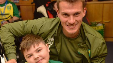 Players from NCFC visit EACH in Quidenham Christoph Zimmermann talks to families Byline: Sonya Dunc