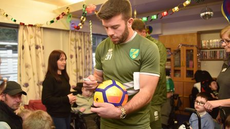 Players from NCFC visit EACH Grant Hanley signs autographs and hands out goody bags.Byline: Sonya Du