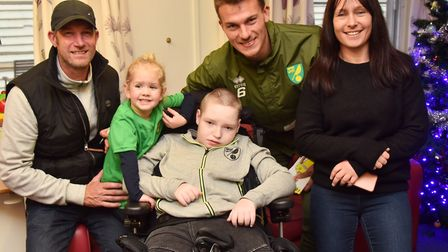 Players from NCFC visit EACH in Quidenham Christoph Zimmermann talks to families Byline: Sonya Dunca