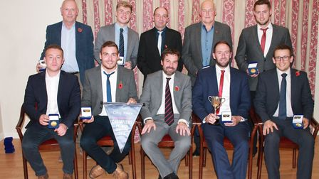 Norfolk Alliance Premier Division champions Fakenham face the camera with Robert Amey (front row, ce