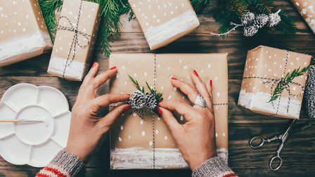 She's got time to wrap her pressents with brown paper decorated with painted snow, fir branches and