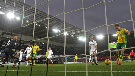 Marco Stiepermann slots home Max Aarons' cross to put Norwich City 3-0 up at Swansea. Picture: Paul