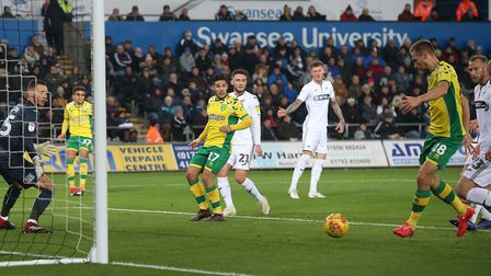 Marco Stiepermann slots home Norwich City's third goal before half-time against Swansea. Picture: Pa