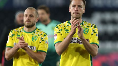 Teemu Pukki (left) and Marco Stiepermann thank the Norwich City traveling support following their 4-