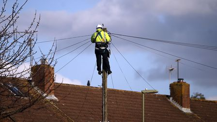 A BT Openreach engineer working on telephone lines. Picture: Steve Parsons/PA Wire