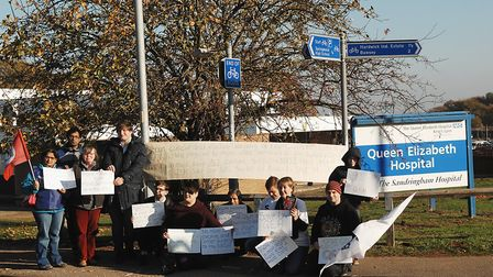 Protesters outside the Queen Elizabeth Hospital, which could send cancer patients to Norwich for ope