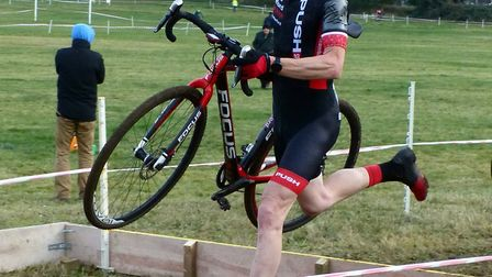 Norwich rider Paul Groombridge (fourth Vet 40-49), flies over the planks at the Diss CC cyclo-cross