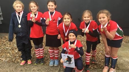 Norwich Dragons' Team Danson, named after England captain Alex Danson, show off their gold medals a