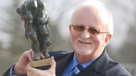 Dennis O'Callaghan with a statue of Private William O'Callaghan carrying Private Albert Pooley from