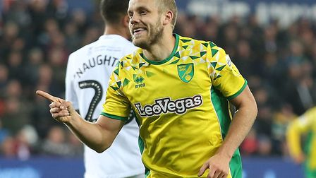 Teemu Pukki celebrates scoring City's fourth goal at Swansea with the away fans Picture: Paul Cheste
