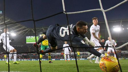 Erwin Mulder of Swansea dives but can't stop Teemu Pukki, out of shot, putting Norwich 4-1 up Pictur