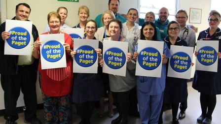 Staff at the James Paget University Hospital (JPUH) celebrate being rated as good by the CQC. Photo: