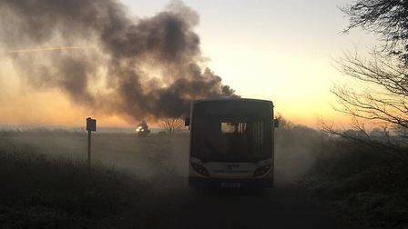 A bus caught fire on the A146 this morning. Photo: Kaye Nichols