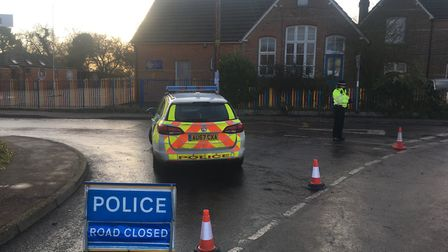 Police close a road in Tiivetshall where an incident has also closed the primary school. Picture: St