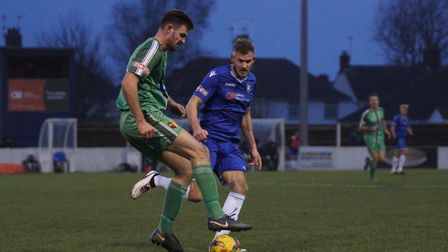 Lowestoft's Shaun Bammant keeps an eye on Alvechurch captain Jamie Willets. Picture: Shirley D Whitl