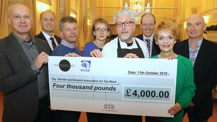 Jeremy Goss of the NNAB (left) receives the cheque from Assembly House head chef Richard Hughes (cen