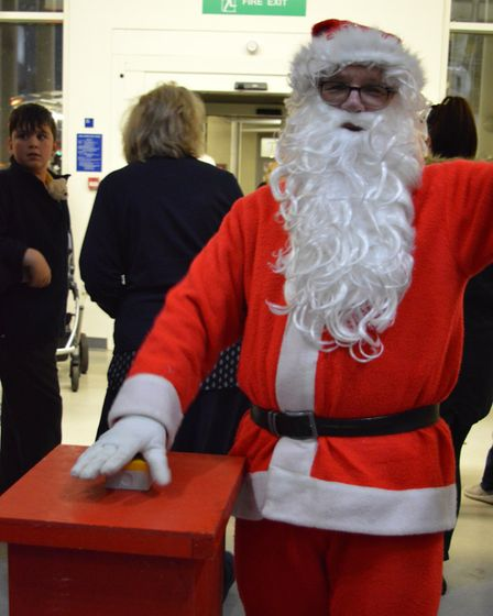 Santa turns on the Christmas lights at the Norfolk and Norwich Hospital. Photo: NNUH