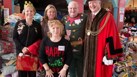 Former mayor of Great Yarmouth Malcolm Bird, his wife and volunteers standing in front of the dontat