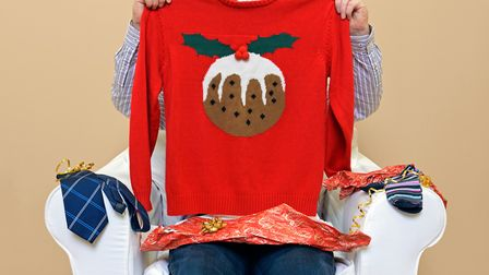No need to buy a new Christmas jumper this year - wear last year's, pick up one from a charity shop