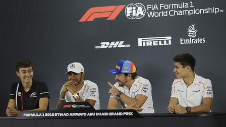 Goerge Russell, far left, shares a press conference in Abu Dhabi with world champion Lewis Hamilton,