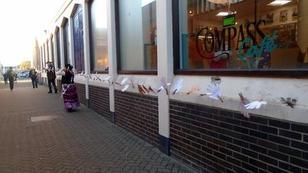 The towns library is ringed with paper hands with colourful characters, some dressed as pirates, en