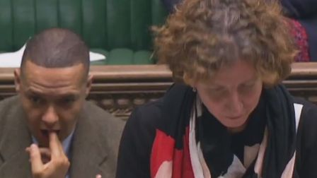 Clive Lewis pictured in the House of Commons seemingly mimicking shooting himself in the mouth. Phot
