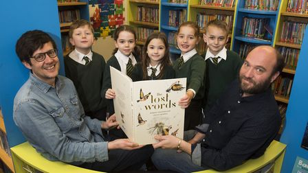 Chrildren from St John's Primary School, Hoveton with a copy of The Lost Words presented by Henry La