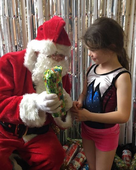 Christmas started in earnest when Thalia saw Father Christmas at the gym club Christmas party. Pictu
