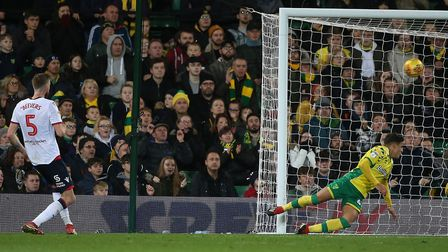 Mark Beevers fired Bolton's equaliser past Max Aarons on the Canaries' goal-line Picture: Paul Chest