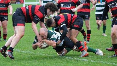 Norwich Union No 8 Jon Spicker powers his way over during his side's 29-15 win at Wymondham II in Ea