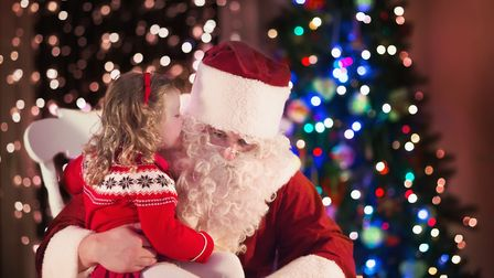 Little girl with Father Christmas. Picture: Getty Images/iStockphoto