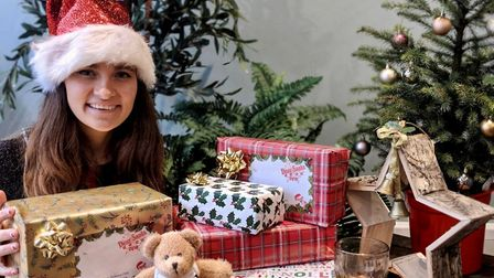 Embrace Child Victims of Crime fundraising manager Chloe Raw with gifts ready for dispatch. Picture: